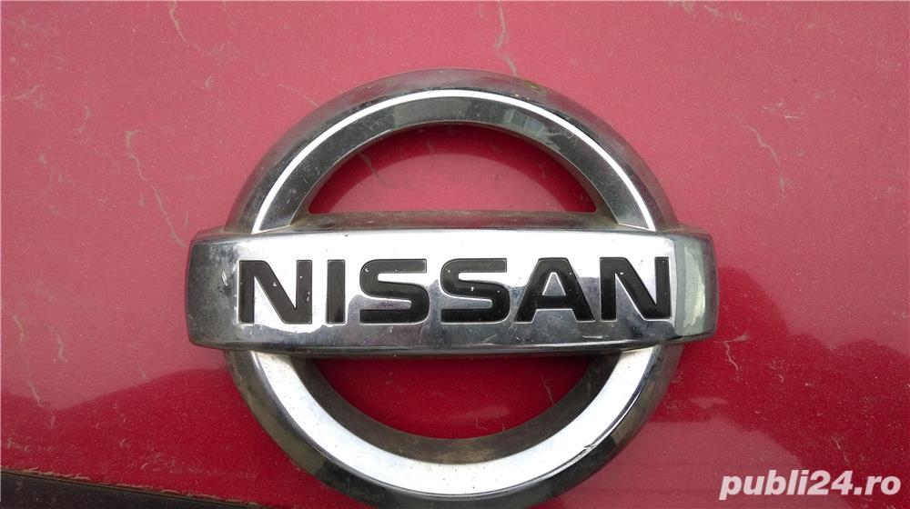 Sigla Nissan Navara D40