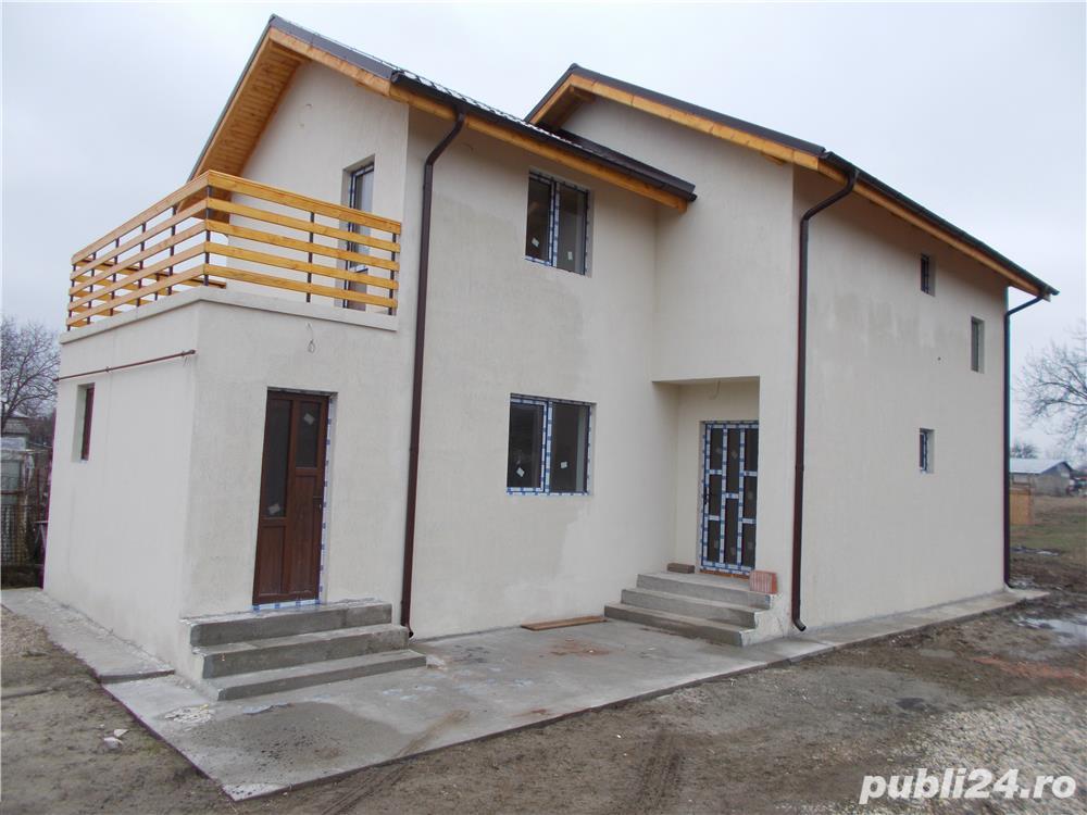 Casa cu 4 camere P+1+terasa 2018 la asfalt bransata la utilitati LA CHEIE cu finisaje merita vazuta