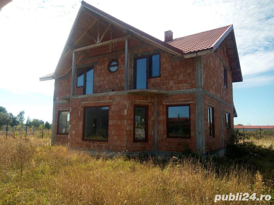 Casa la rosu in Busag, 180 mp, inchisa cu termopan si tencuita