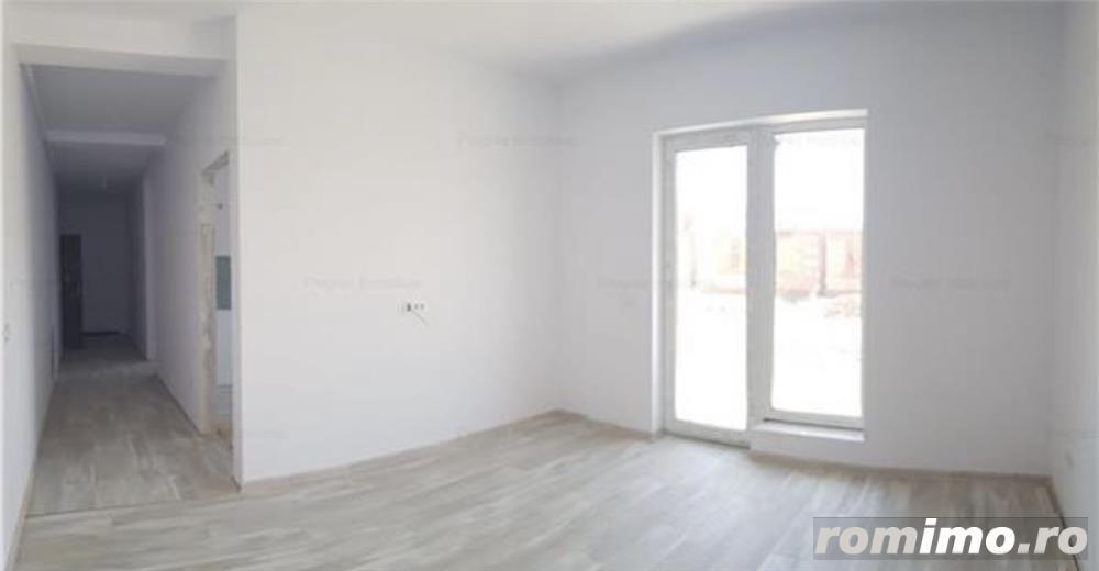 Ap. cu 2 camere decomandat+ curte proprie-61.000 euro
