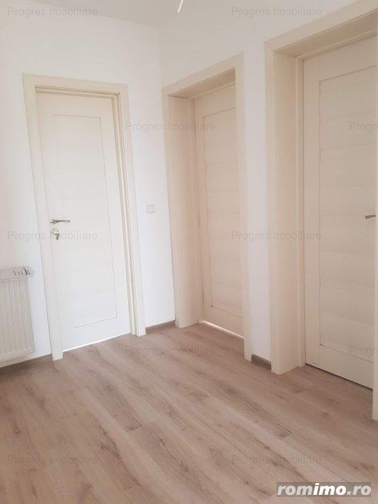 Apartament  2 camere,2 bai, 62mp - 63000 euro. Decomandat