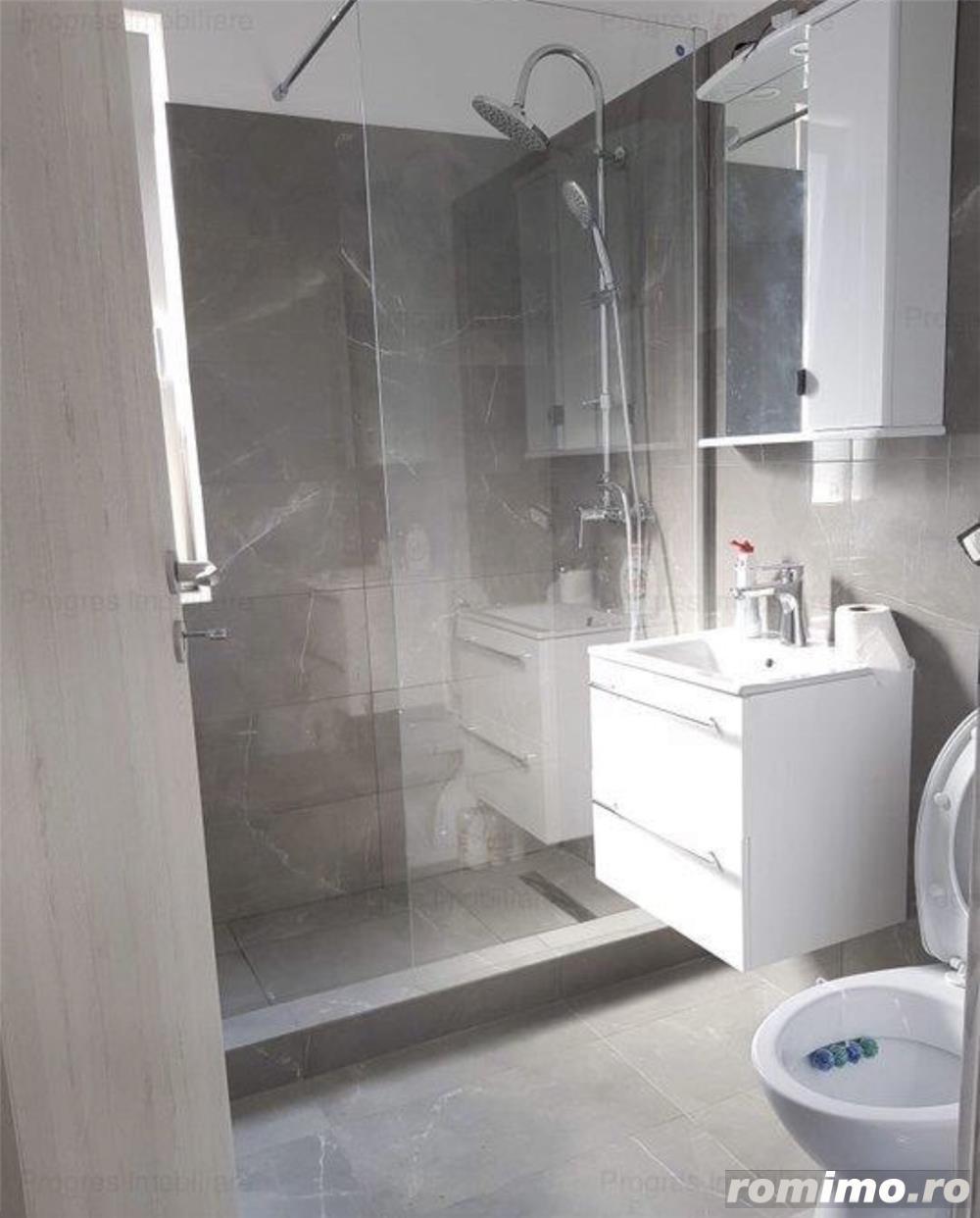 Ap. 3 camere in vila cu 4 apartamente-66.000 euro