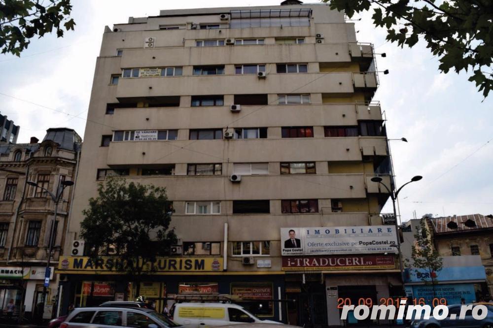 Piata Romana 4 camere etaj 4/8 semidecomandat ideal birou/locuinta