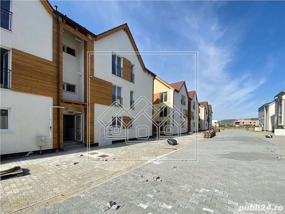 Ap.nou si complet decomandat, etaj intermediar, loc de parcare -Selimbar