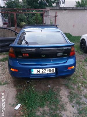 Mazda 323 - imagine 4