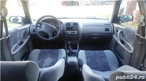 Mazda 323 - imagine 6