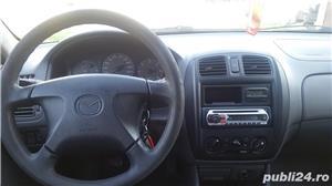 Mazda 323 - imagine 8