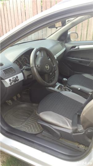 Opel Astra - imagine 7