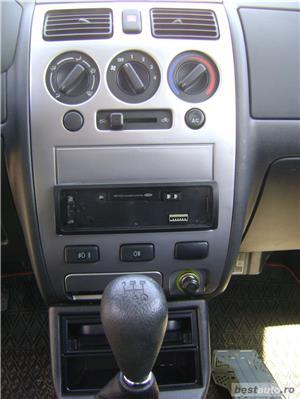 Daihatsu sirion - imagine 6