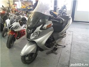 Dezmembrez Suzuki Burgam - imagine 1