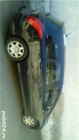 Peugeot 308 7 locuri - imagine 4