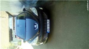 Peugeot 308 7 locuri - imagine 1