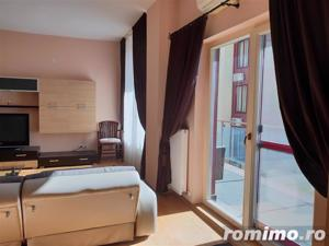 Apartament nou, central cu garaj de inchiriat - imagine 2