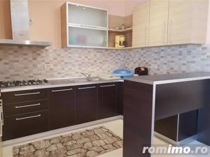 Apartament nou, central cu garaj de inchiriat - imagine 3