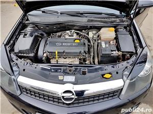 Opel Astra - imagine 13
