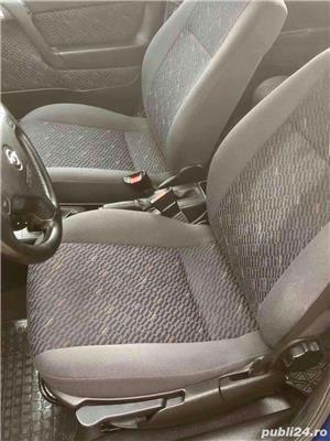Opel Astra G 1.6i euro 4 120000km cu carte service - imagine 9