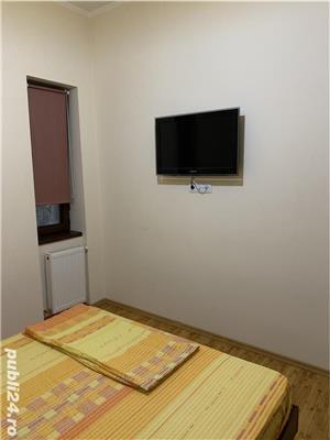 Sc inchiriaza in regim hotelier ap cu 2 cam in centru - imagine 10