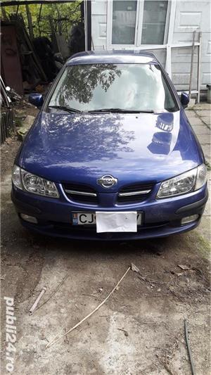 Nissan almera - imagine 1