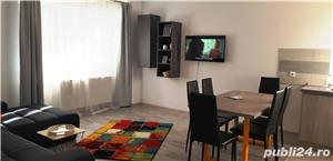 Cazare apartament 3 camere in regim hotelier - 6 persoane - imagine 1