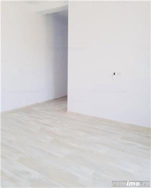 Ap. cu 2 camere decomandat+ curte proprie-61.000 euro - imagine 4