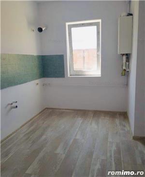 Ap. cu 2 camere decomandat+ curte proprie-61.000 euro - imagine 8