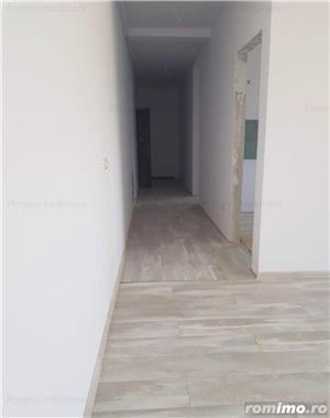 Ap. cu 2 camere decomandat+ curte proprie-61.000 euro - imagine 2