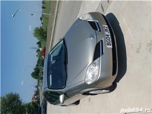 Nissan Primera - imagine 1