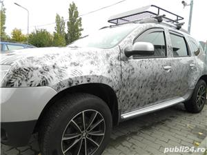 Dacia Duster 1.5 dci - imagine 1