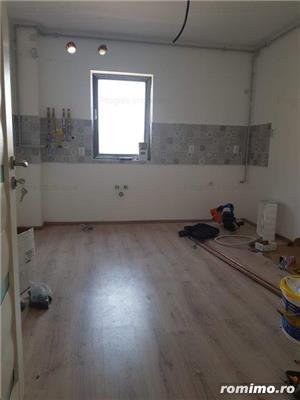 Apartament  2 camere,2 bai, 62mp - 63000 euro. Decomandat - imagine 4