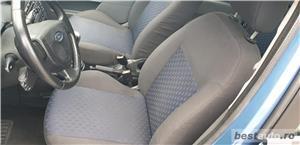 Ford Fiesta DIESEL 1,4 AN 2004 - imagine 4