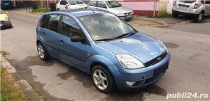 Ford Fiesta 1,4 DIESEL 2004 - imagine 2