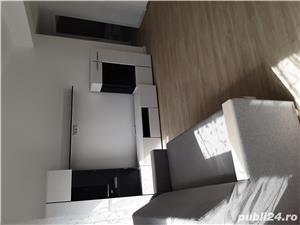 Închiriez apartament într-o casă stil duplex. - imagine 6