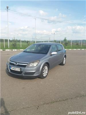 Opel Astra - imagine 15