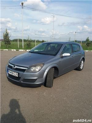 Opel Astra - imagine 18