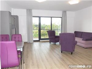 Apartament 2 camere nou mobilat si utilat, 64mp+balcon 10mp, garaj subteran - imagine 2