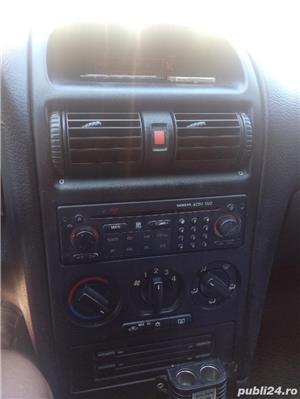 Opel Astra - imagine 6