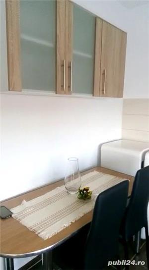 inchiriez apartament, bucataria dotata mobilata ,doua bai,doua camere nemobilata ,zona Coresi tracto - imagine 2
