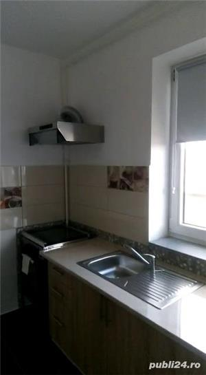 inchiriez apartament, bucataria dotata mobilata ,doua bai,doua camere nemobilata ,zona Coresi tracto - imagine 1