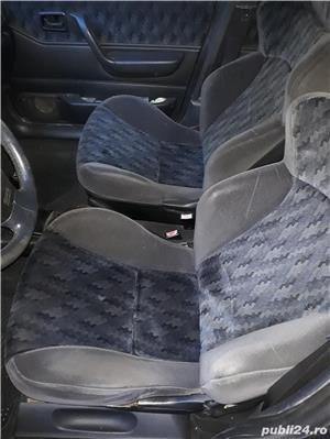 Ford Fiesta Ghia 1.6 90 hp - imagine 4
