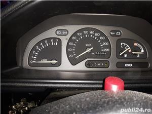 Ford Fiesta Ghia 1.6 90 hp - imagine 2