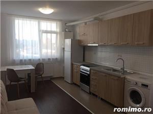 Ofer spre inchiriere un apartament complet utilat si mobilat modern - imagine 4